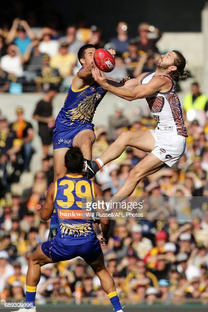 Liam Duggan of the Eagles and Callan Ward of the Giants leap for the ball during the round 10 AFL match between the West Coast Eagles and the Greater...