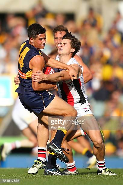 Liam Duggan of the Eagles gets tackled by Jack Sinclair of the Saints during the round eight AFL match between the West Coast Eagles and the St Kilda...