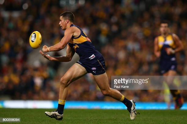 Liam Duggan of the Eagles handballs during the round 14 AFL match between the West Coast Eagles and the Melbourne Demons at Domain Stadium on June 24...