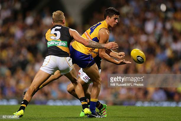 Liam Duggan of the Eagles handballs under pressure from Brandon Ellis of the Tigers during the round four AFL match between the West Coast Eagles and...