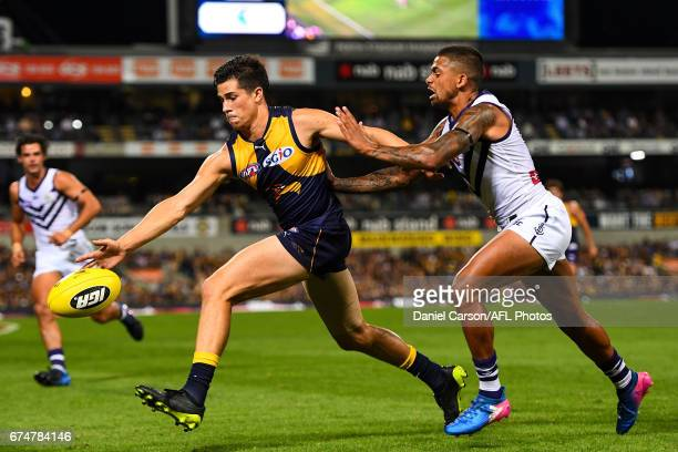 Liam Duggan of the Eagles leads to the ball in front of Bradley Hill of the Dockers during the 2017 AFL round 06 match between the West Coast Eagles...