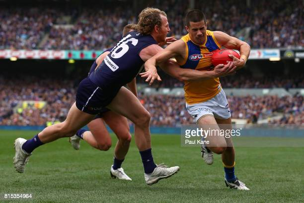 Liam Duggan of the Eagles looks to break from a tackle by David Mundy of the Dockers during the round 17 AFL match between the Fremantle Dockers and...