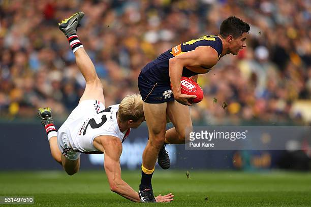 Liam Duggan of the Eagles shrugs a tackle by Nick Riewoldt of the Saints during the round eight AFL match between the West Coast Eagles and the St...