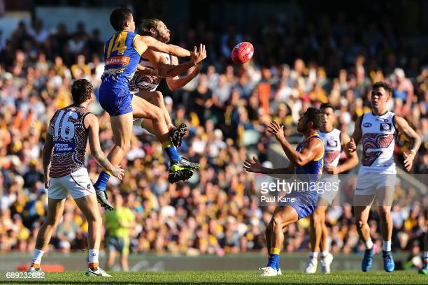 Liam Duggan of the Eagles spoils the mark for Callan Ward of the Giants during the round 10 AFL match between the West Coast Eagles and the Greater...