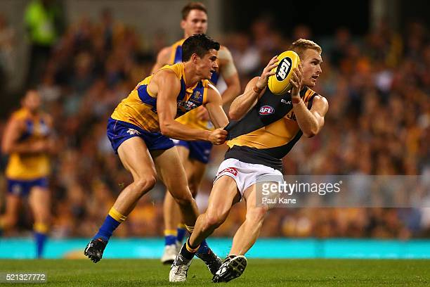 Liam Duggan of the Eagles tackles Andrew Moore of the Tigers during the round four AFL match between the West Coast Eagles and the Richmond Tigers at...