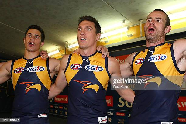 Liam Duggan Sam Butler and Shannon Hurn of the Eagles sing the club song after winning the round 18 AFL match between the West Coast Eagles and the...