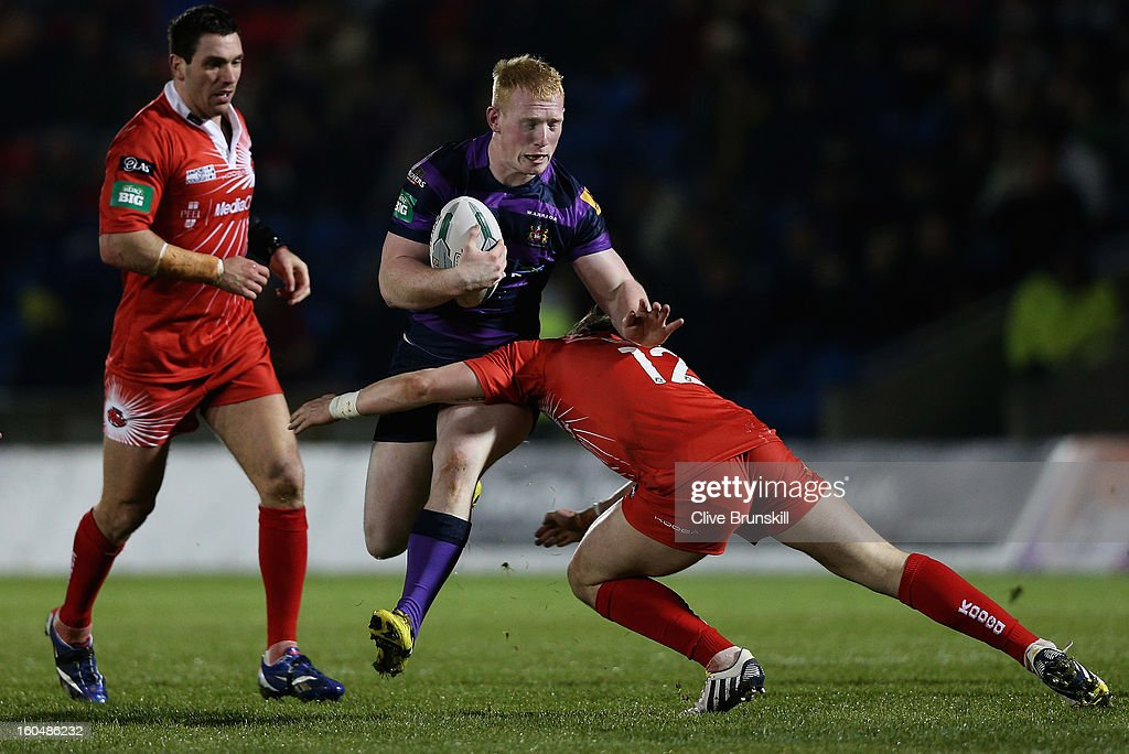 Liam Farrell of Wigan Warriors attempts to move past Andrew Dixon of Salford City Reds during the Super League match between Salford City Reds and Wigan Warriors at Salford City Stadium on February 1, 2013 in Salford, England.