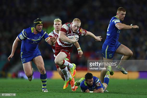Liam Farrell of Wigan winner of the man of the match award breaks through the Warrington defence to set up his sides first try during the First...