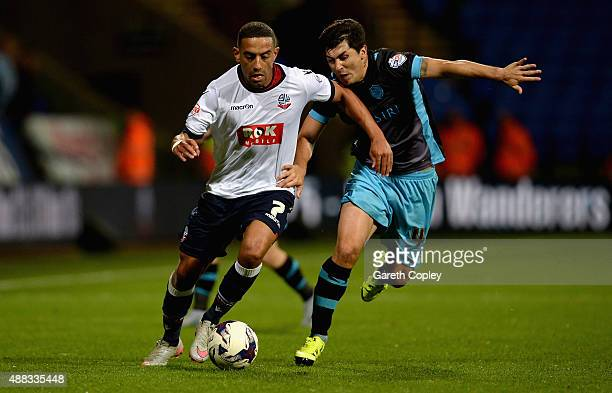 Liam Feeney of Bolton is tackled by Fernando Forestieri of Sheffield Wednesday during the Sky Bet Championship match between Bolton Wanderers and...