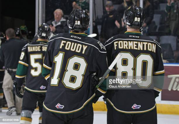 Liam Foudy and Alex Formenton of the London Knights leave the ice after a victory against the Kitchener Rangers in an OHL game at Budweiser Gardens...