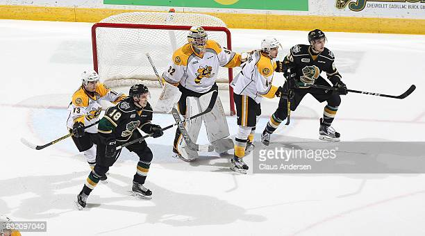 Liam Foudy and Alex Formenton of the London Knights work on offense against Justin Fazio and Jeff King of the Sarnia Sting during an OHL game at...