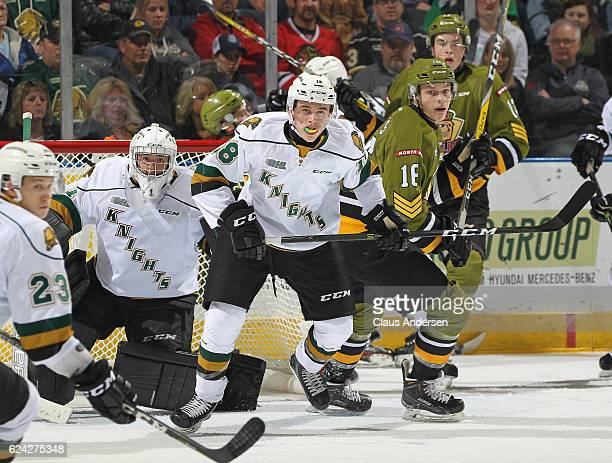 Liam Foudy and Tyler Parsons of the London Knights watch for a puck against the North Bay Battalion during an OHL game at the Budweiser Gardens on...