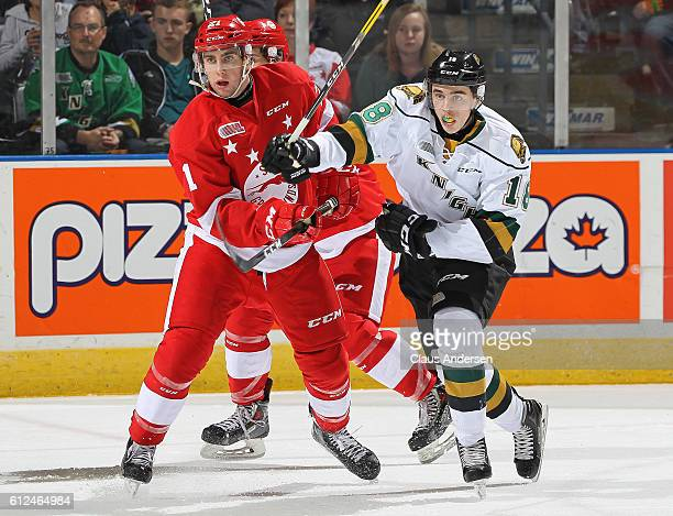 Liam Foudy of the London Knights battles against Conor Timmins of the Sault Ste Marie Greyhounds during an OHL game on Sept 30 2016 at Budweiser...