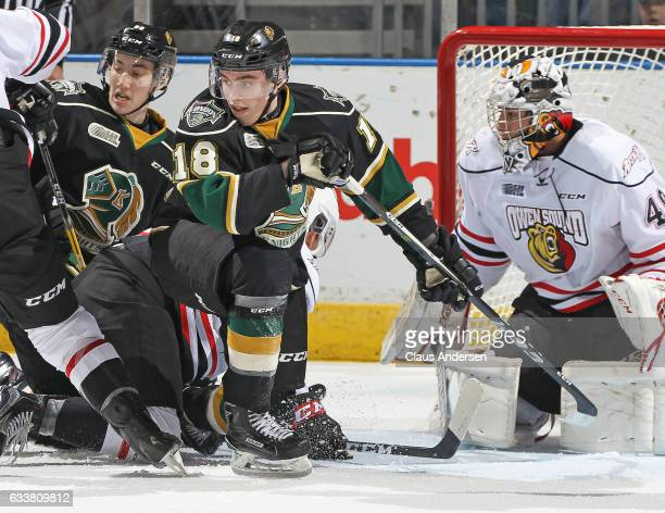 Liam Foudy of the London Knights battles against the Owen Sound Attack during an OHL game at Budweiser Gardens on February 3 2017 in London Ontario...