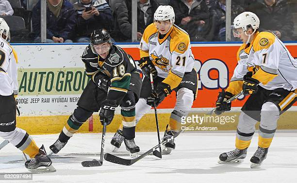 Liam Foudy of the London Knights battles for a puck against Adam Ruzicka of the Sarnia Sting during an OHL game at Budweiser Gardens on January 18...