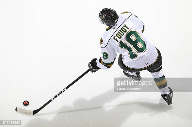 Liam Foudy of the London Knights gets set to pass the puck against the Saginaw Spirit during an OHL game at Budweiser Gardens on October 21 2016 in...