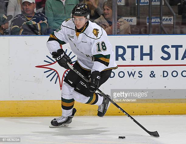 Liam Foudy of the London Knights skates with the puck against the Windsor Spitfires during an OHL game at Budweiser Gardens on October 142016 in...