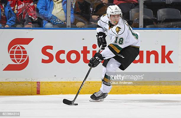 Liam Foudy of the London Knights skates with the puck against the Kingston Frontenacs during an OHL game at Budweiser Gardens on November 11 2016 in...