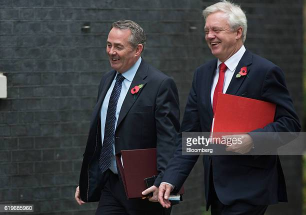 Liam Fox UK international trade secretary left and David Davis UK exiting the European Union secretary right arrives for the weekly cabinet meeting...