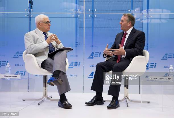 Liam Fox UK international trade secretary right speaks while Claude Barfield resident scholar for American Enterprise Institute listens during a...