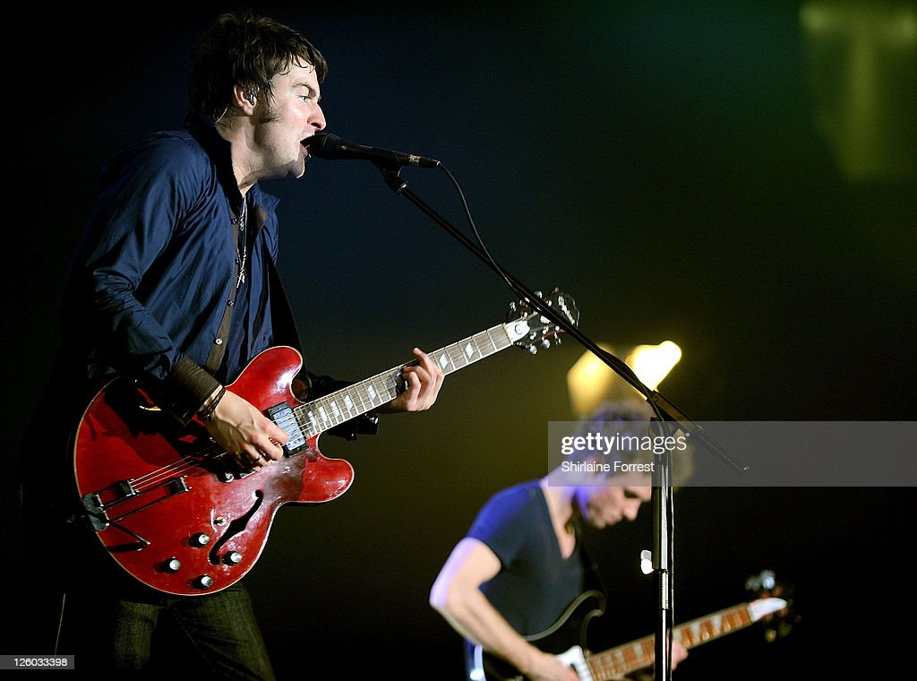 COVERAGE ** Liam Fray and Mark Cuppello of The Courteeners perform during a homecoming show at MEN Arena on December 10 2010 in Manchester England