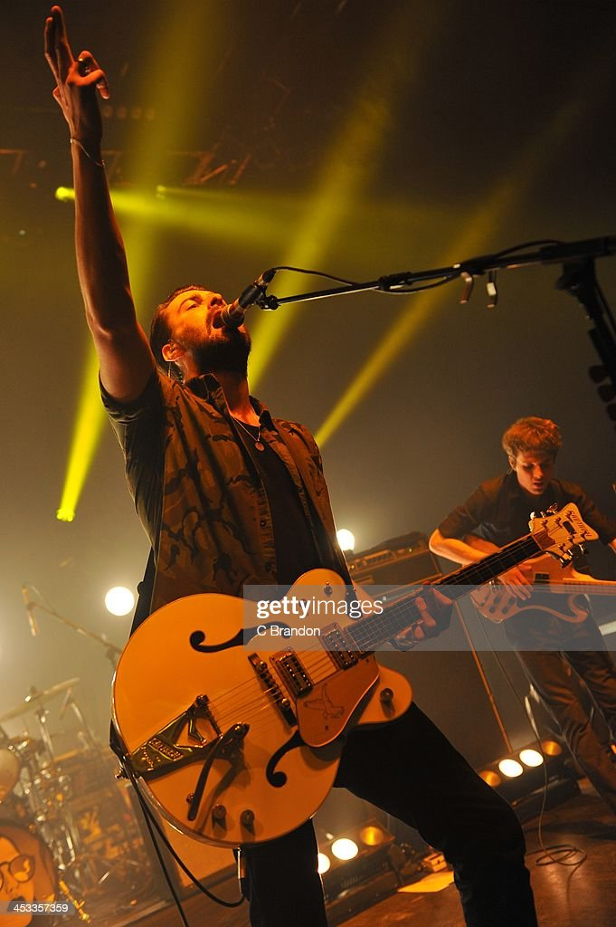 Liam Fray and Mark Cuppello of The Courteeners perform on stage at Shepherds Bush Empire on December 3 2013 in London United Kingdom