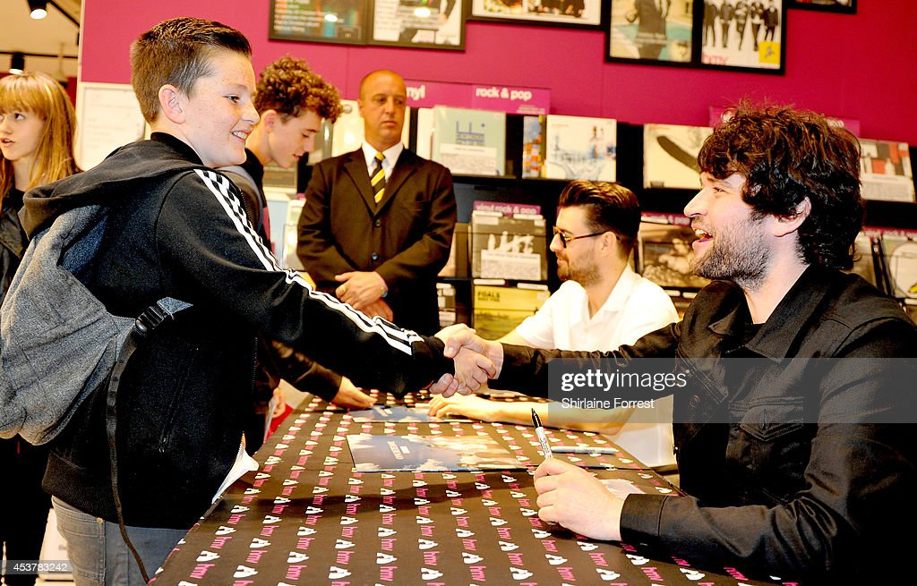 Liam Fray and Michael Campbell of The Courteeners sign copies of their new album 'Concrete Love' at HMV Manchester on August 18 2014 in Manchester...