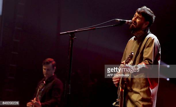 Liam Fray of the British indie rock band Courtenners performs with his band during the 'We Are Manchester' charity concert at the Manchester Arena in...