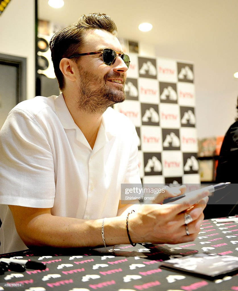 Liam Fray of The Courteeners signs copies of their new album 'Concrete Love' at HMV Manchester on August 18 2014 in Manchester England