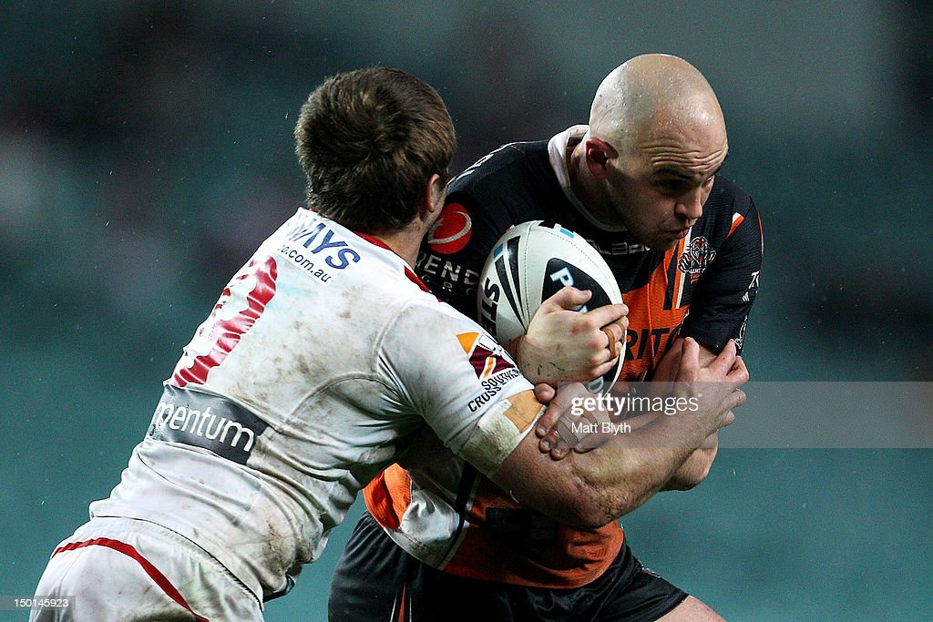 Liam Fulton of the Tigers is tackled during the round 23 NRL match between the Wests Tigers and the St George Illawarra Dragons at Allianz Stadium on August 11, 2012 in Sydney, Australia.