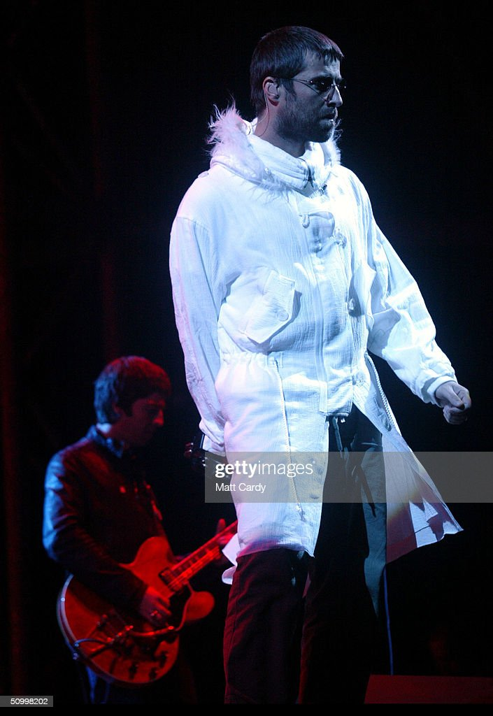 Liam Gallagher (R) and <a gi-track='captionPersonalityLinkClicked' href=/galleries/search?phrase=Noel+Gallagher&family=editorial&specificpeople=209146 ng-click='$event.stopPropagation()'>Noel Gallagher</a> of Oasis perform on the Pyramid Stage during the 2004 Glastonbury Festival, on June 25, 2004 at Worthy Farm, Pilton, Somerset, England. The music festival spans over 3 days and runs until June 27.