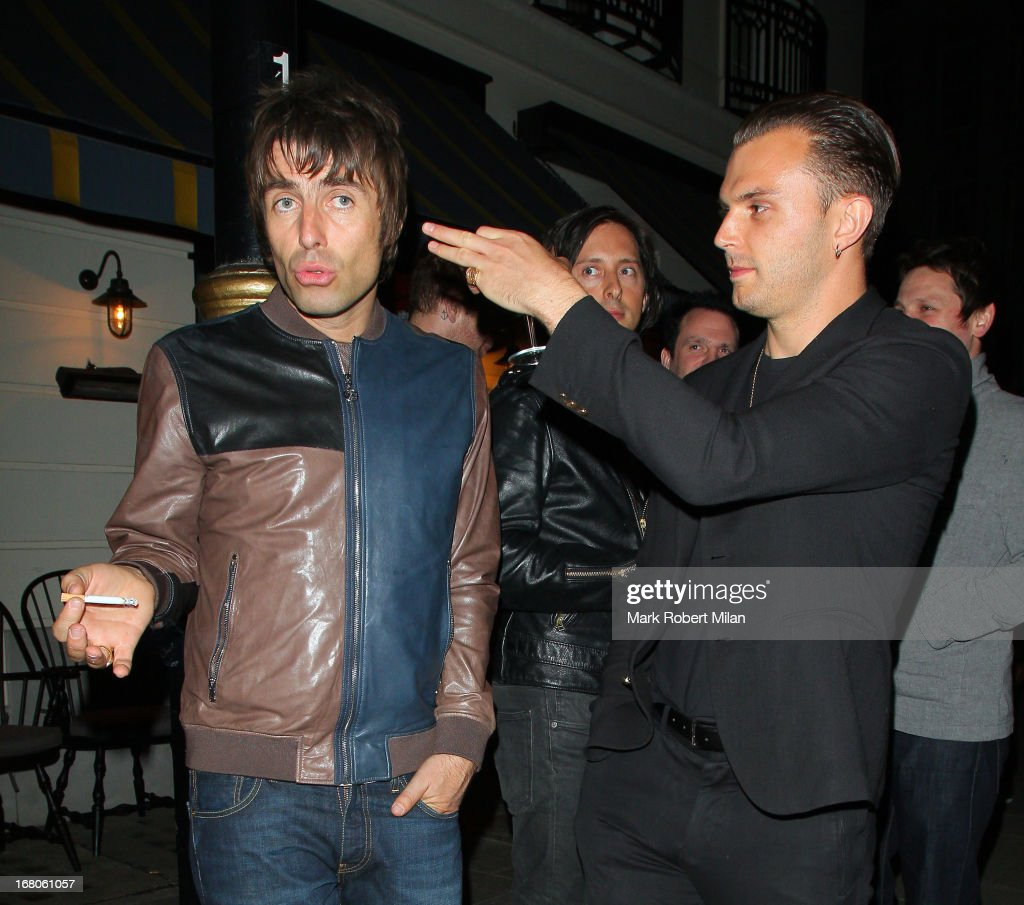 <a gi-track='captionPersonalityLinkClicked' href=/galleries/search?phrase=Liam+Gallagher&family=editorial&specificpeople=202958 ng-click='$event.stopPropagation()'>Liam Gallagher</a> (L) at The Little House club on May 4, 2013 in London, England.