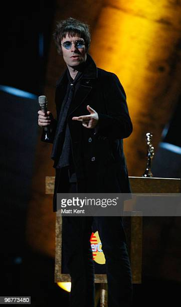 Liam Gallagher formerly of Oasis accepts the award for 'British Album of 30 Years' on stage at The Brit Awards 2010 at Earls Court on February 16...