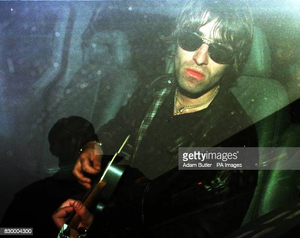 Liam Gallagher lead singer of the rock band Oasis sits in the back of a darkened limosine at Gatwick airport after returning from Mexico today at the...