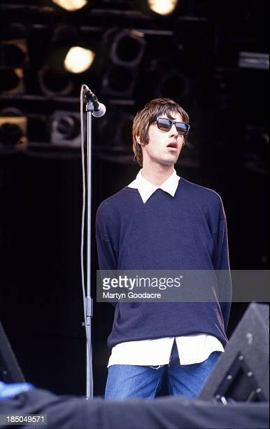 Liam Gallagher of Oasis performs on stage at Glastonbury United Kingdom 1994