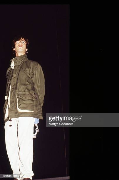 Liam Gallagher of Oasis performs on stage at Glastonbury United Kingdom 1995