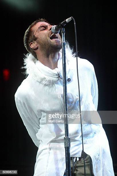 Liam Gallagher of Oasis performs on the Pyramid Stage during the 2004 Glastonbury Festival on June 25 2004 at Worthy Farm Pilton Somerset England The...