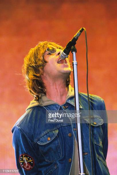 Liam Gallagher of Oasis playing Wembley Stadium in 2000