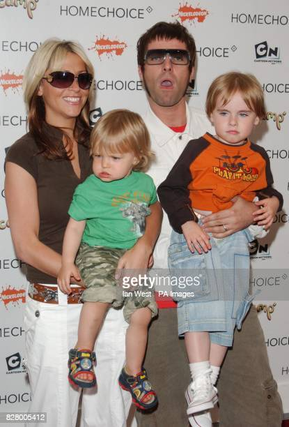 Liam Gallagher of Oasis with his fiancee Nicole Appleton their son Gene and nephew Ace
