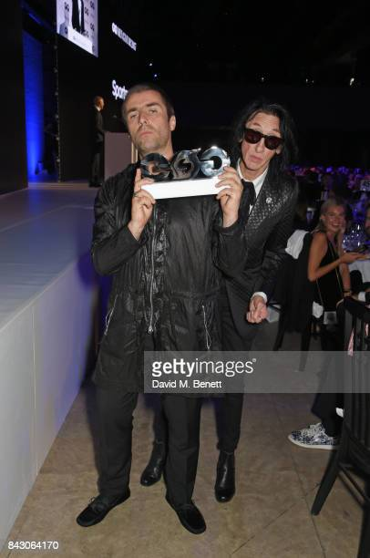 Liam Gallagher winner of the Rock n'Roll Star of the Year award and John Cooper Clarke attend the GQ Men Of The Year Awards at the Tate Modern on...