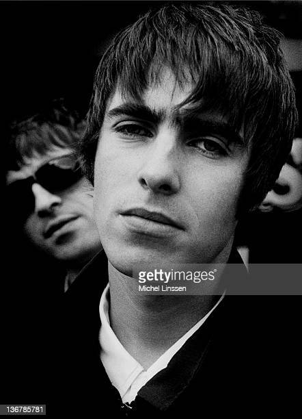 Liam Gallagher with Noel Gallagher behind from English rock band Oasis posed in The Netherlands in 1994