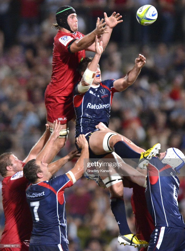 Liam Gill of the Reds and Sean McMahon of the Rebels compete at the lineout during the Super Rugby trial match between the Queensland Reds and the Melbourne Rebels at Ballymore Stadium on February 14, 2014 in Brisbane, Australia.