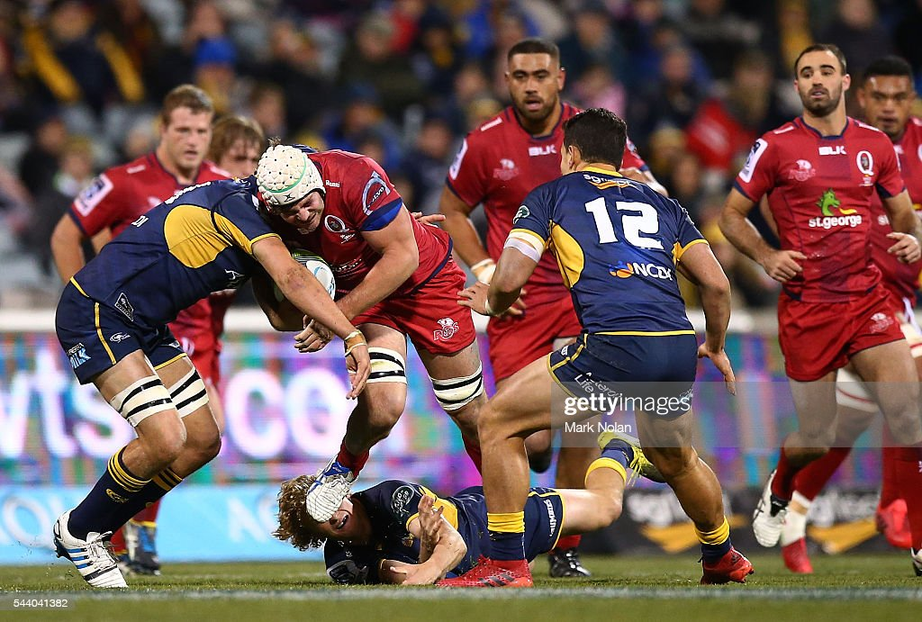 <a gi-track='captionPersonalityLinkClicked' href=/galleries/search?phrase=Liam+Gill&family=editorial&specificpeople=6738623 ng-click='$event.stopPropagation()'>Liam Gill</a> of the Reds is tackled during the round 15 Super Rugby match between the Brumbies and the Reds at GIO Stadium on July 1, 2016 in Canberra, Australia.