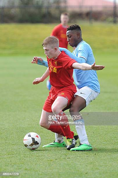 Liam Griffin of Liverpool and Denziel Boadu of Manchester City in action during the Barclays Premier League Under 18 fixture between Liverpool and...
