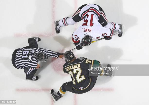 Liam Hawel of the Guelph Storm takes a faceoff against Janne Kuokkanen of the London Knights during an OHL game at Budweiser Gardens on March 9 2017...