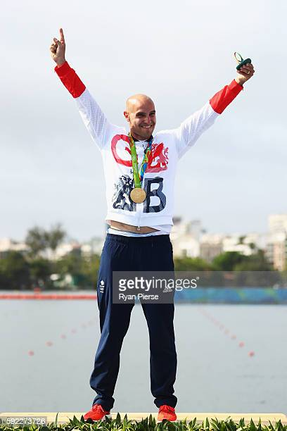 Liam Heath of Great Britain celebrates winning the gold medal in the Men's Kayak Single 200m Finals on Day 15 of the Rio 2016 Olympic Games at the...