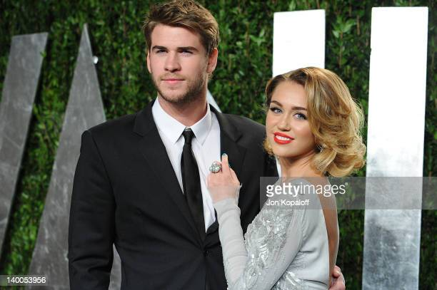 Liam Hemsworth and Miley Cyrus attend the 2012 Vanity Fair Oscar Party at Sunset Tower on February 26 2012 in West Hollywood California