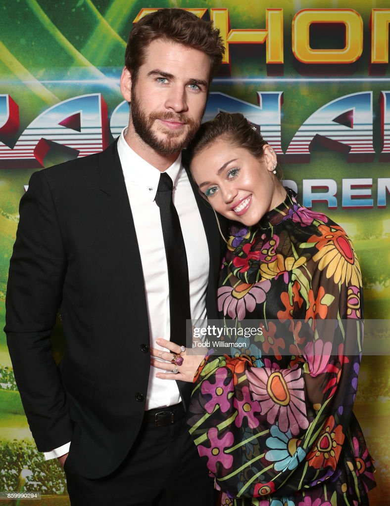 Liam Hemsworth and Miley Cyrus attend the premiere of Disney And Marvel's 'Thor: Ragnarok' on October 10, 2017 in Los Angeles, California.