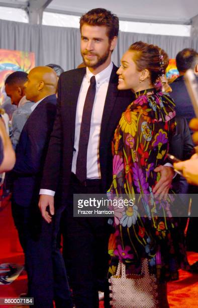 Liam Hemsworth and Miley Cyrus attend the Premiere Of Disney And Marvel's 'Thor Ragnarok' Arrivals on October 10 2017 in Los Angeles California
