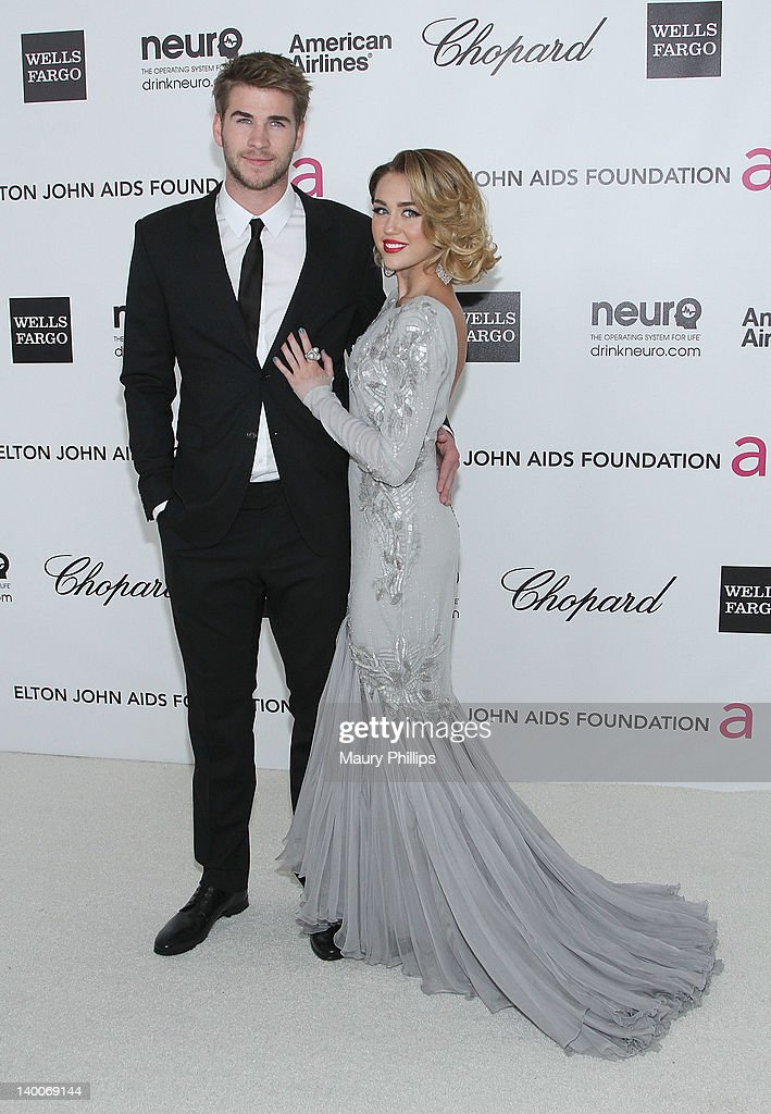 Liam Hemsworth and singer/actress <a gi-track='captionPersonalityLinkClicked' href=/galleries/search?phrase=Miley+Cyrus&family=editorial&specificpeople=3973523 ng-click='$event.stopPropagation()'>Miley Cyrus</a> arrive at the 20th Annual Elton John AIDS Foundation Academy Awards Viewing Party at Pacific Design Center on February 26, 2012 in West Hollywood, California.